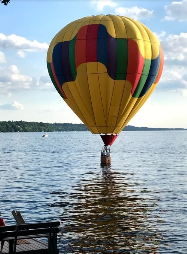 yellow hot air balloon on the water